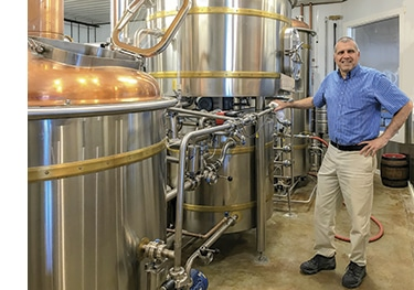 Northern Maine Brewing co-owner Chris Bell shows off his Austrian Fleck's Brauhaus Technik brewing system